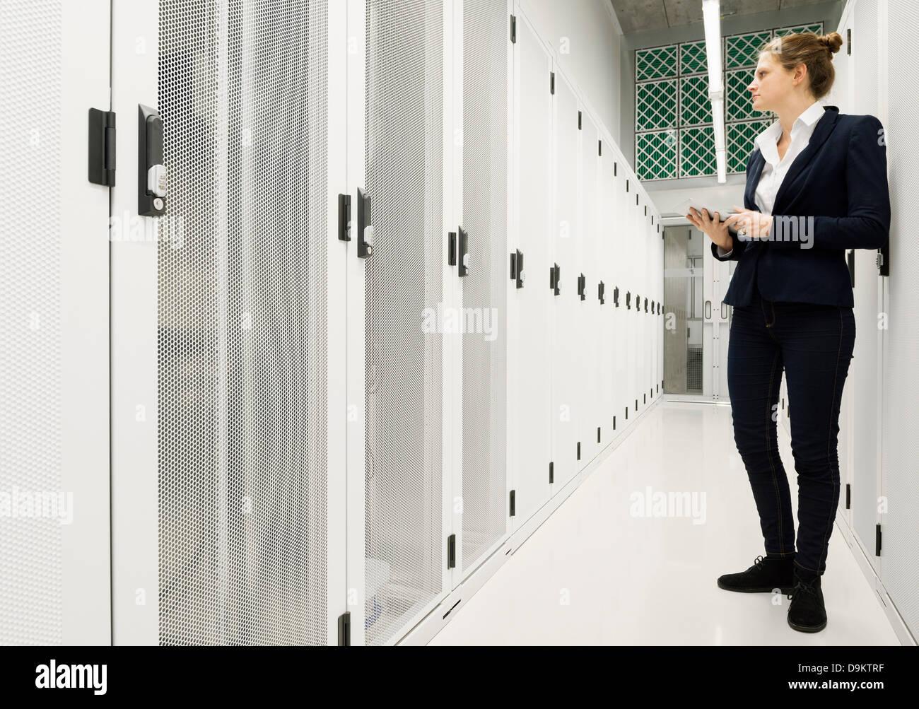Employee working in data storage warehouse - Stock Image