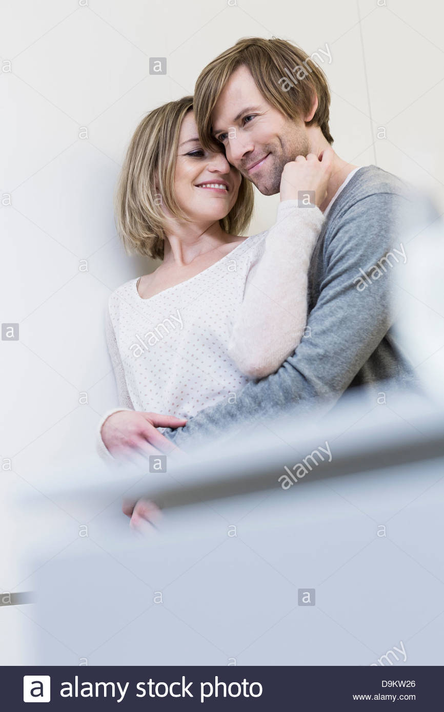 Loving couple, woman touching man's face - Stock Image