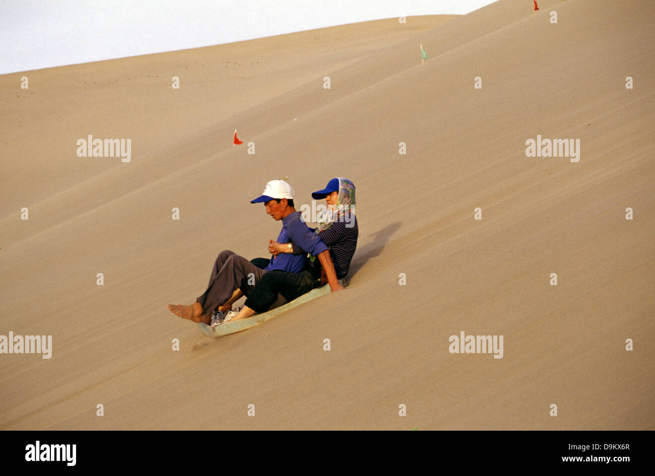 Dune Surfing At Mingsha Shan The Singing Sand Dunes On