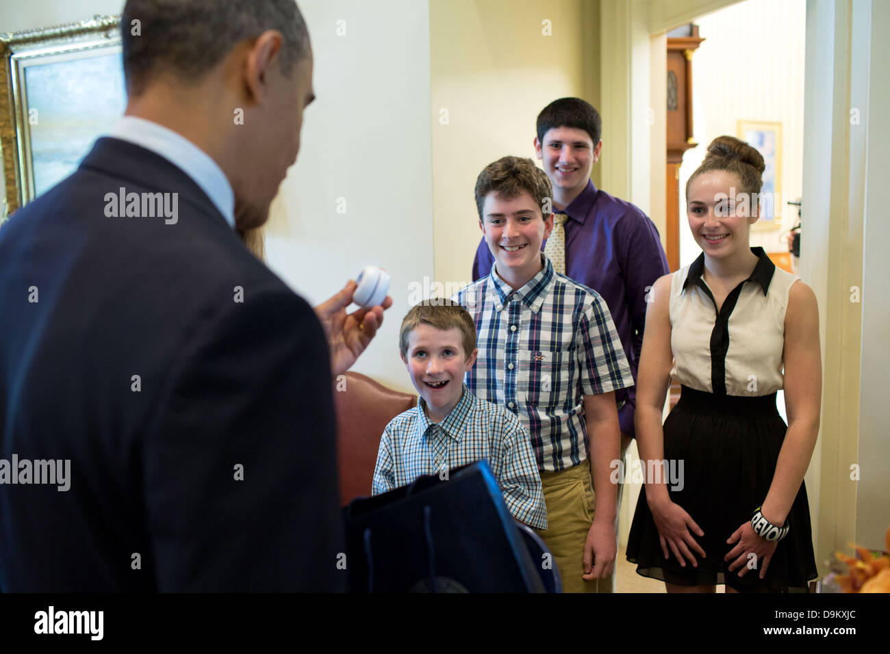 US President Barack Obama holds a yoyo as he talks with guests children in the Outer Oval Office May 31, 2013 in - Stock Image