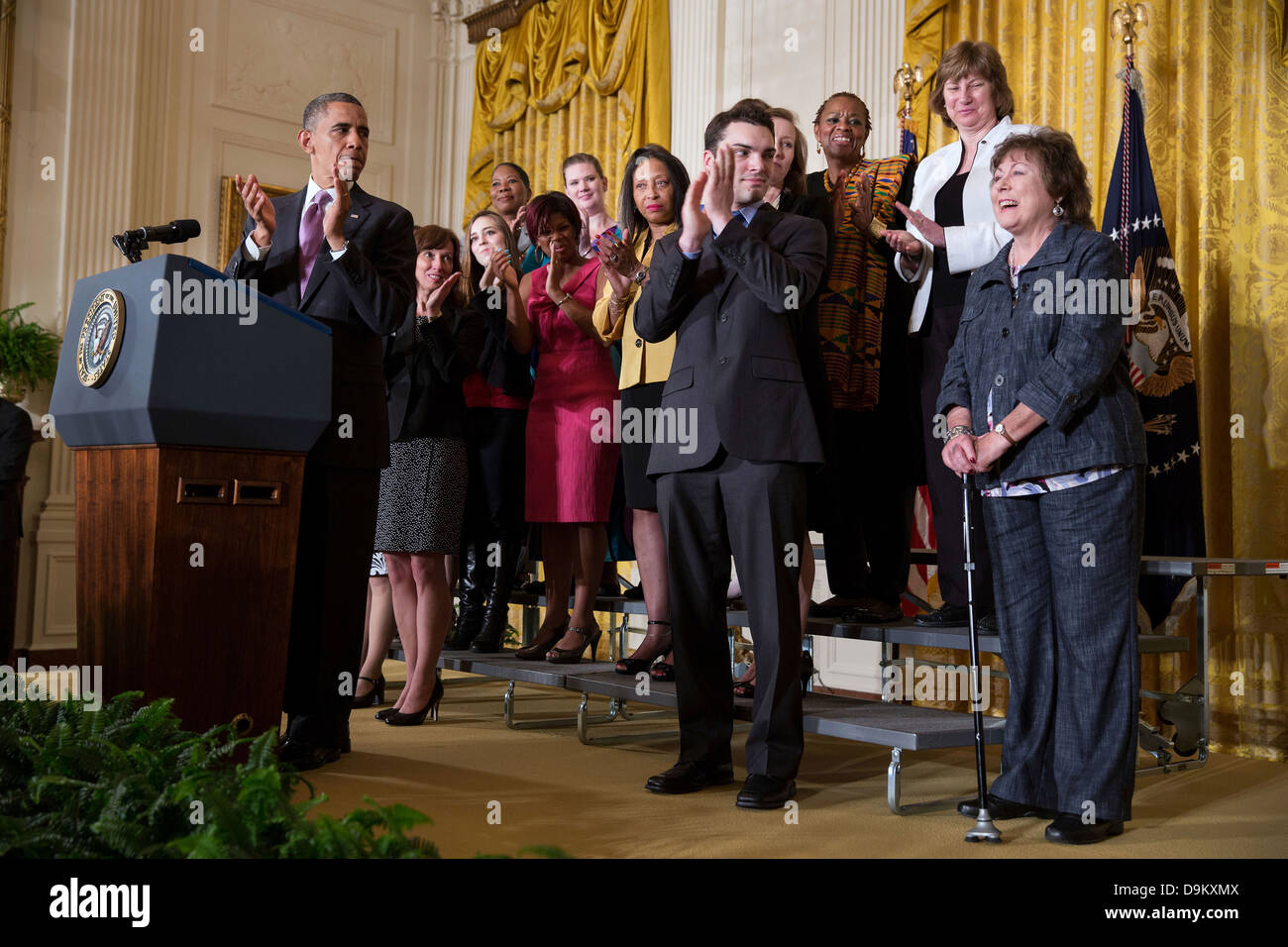 US President Barack Obama recognizes Natoma Canfield, right, during a statement on the Affordable Care Act in the - Stock Image