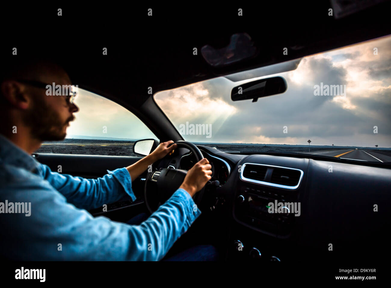 Mid adult man driving car - Stock Image