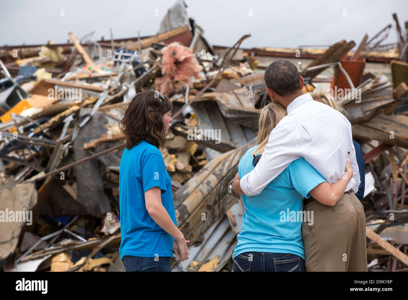 US President Barack Obama hugs Amy Simpson, principal of Plaza Towers Elementary School, outside what remains of - Stock Image