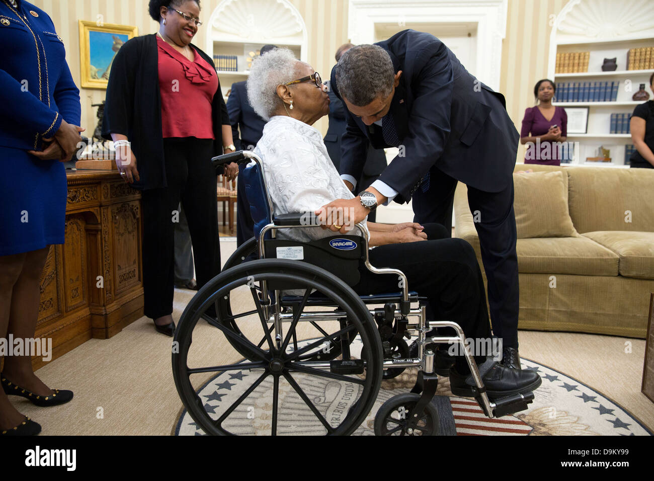 US President Barack Obama talks with Thelma Maxine Pippen McNair, mother of Denise McNair, after signing H.R. 360 Stock Photo