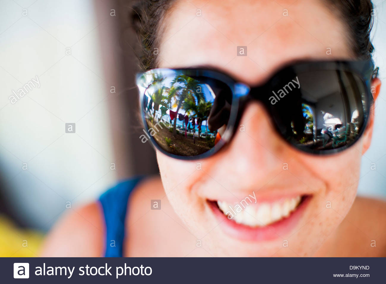 Drying bathing suits reflected in woman's sunglasses - Stock Image