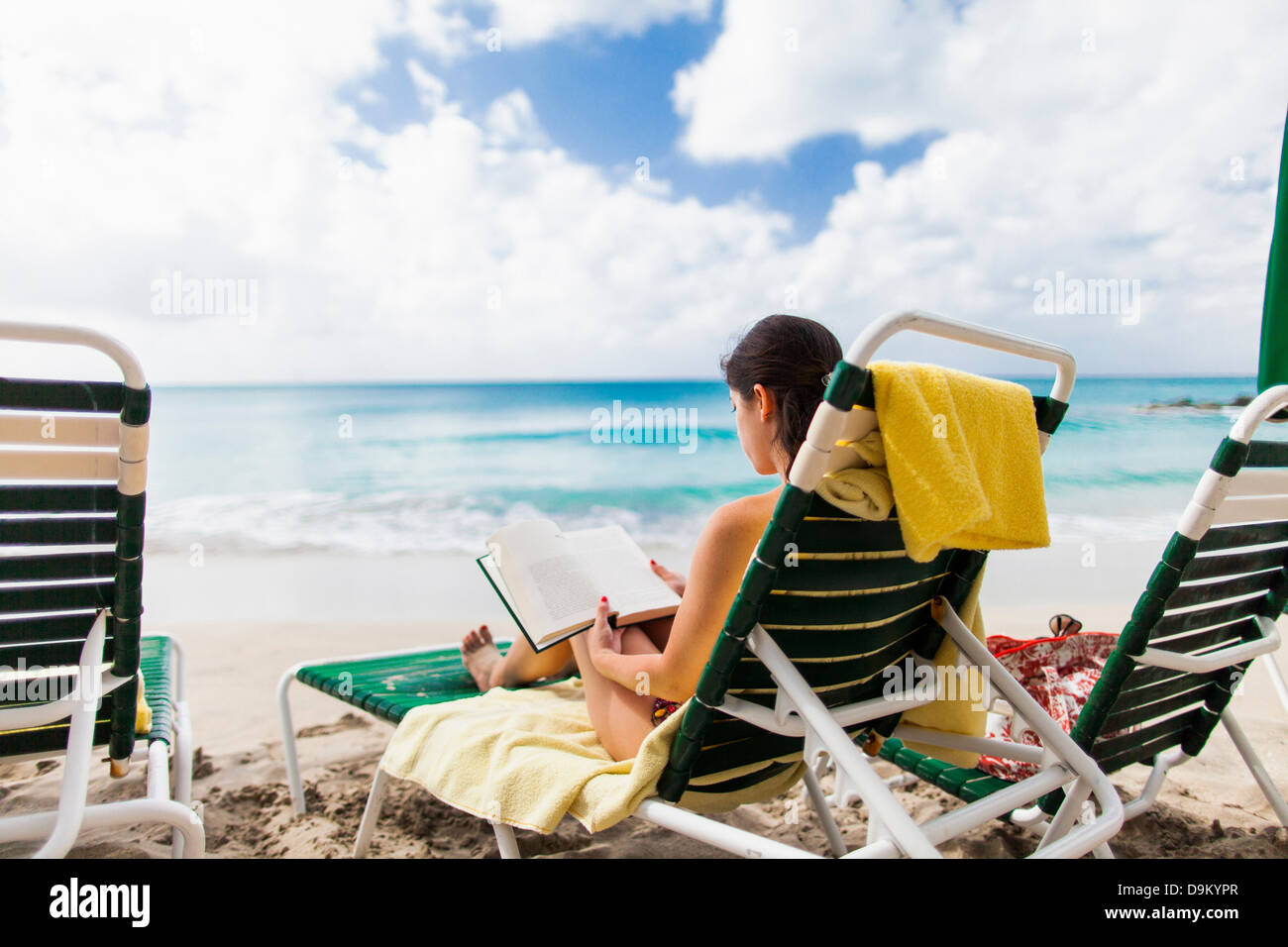 Woman reading book on beach, St Maarten, Netherlands - Stock Image