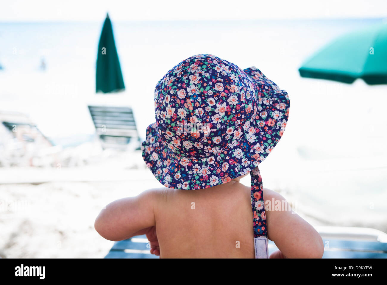 Baby girl wearing sunhat, St Maarten, Netherlands Stock Photo