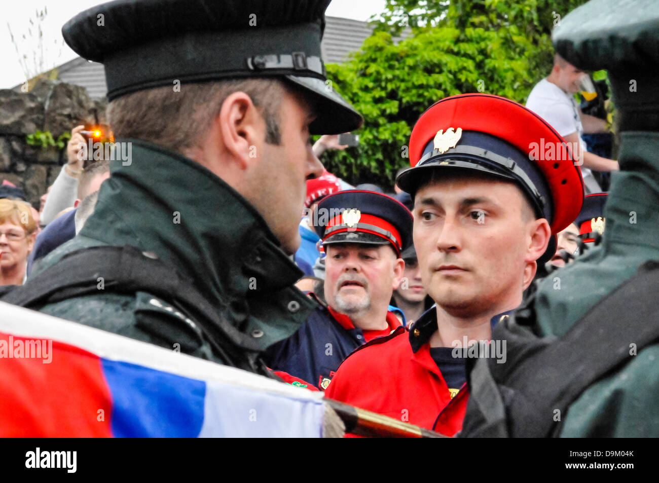 Belfast, Northern Ireland. 21st June 2013.  A loyalist member of the colour party lowers flag his flag through the - Stock Image