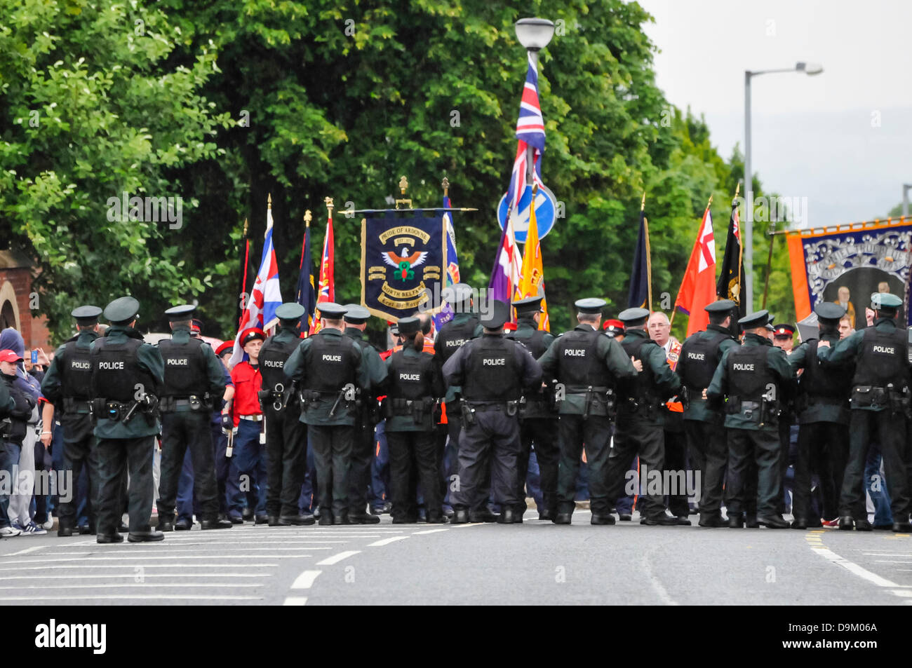Belfast, Northern Ireland. 21st June 2013.  Uniformed police hold a line to stop around 300 loyalists proceeding - Stock Image