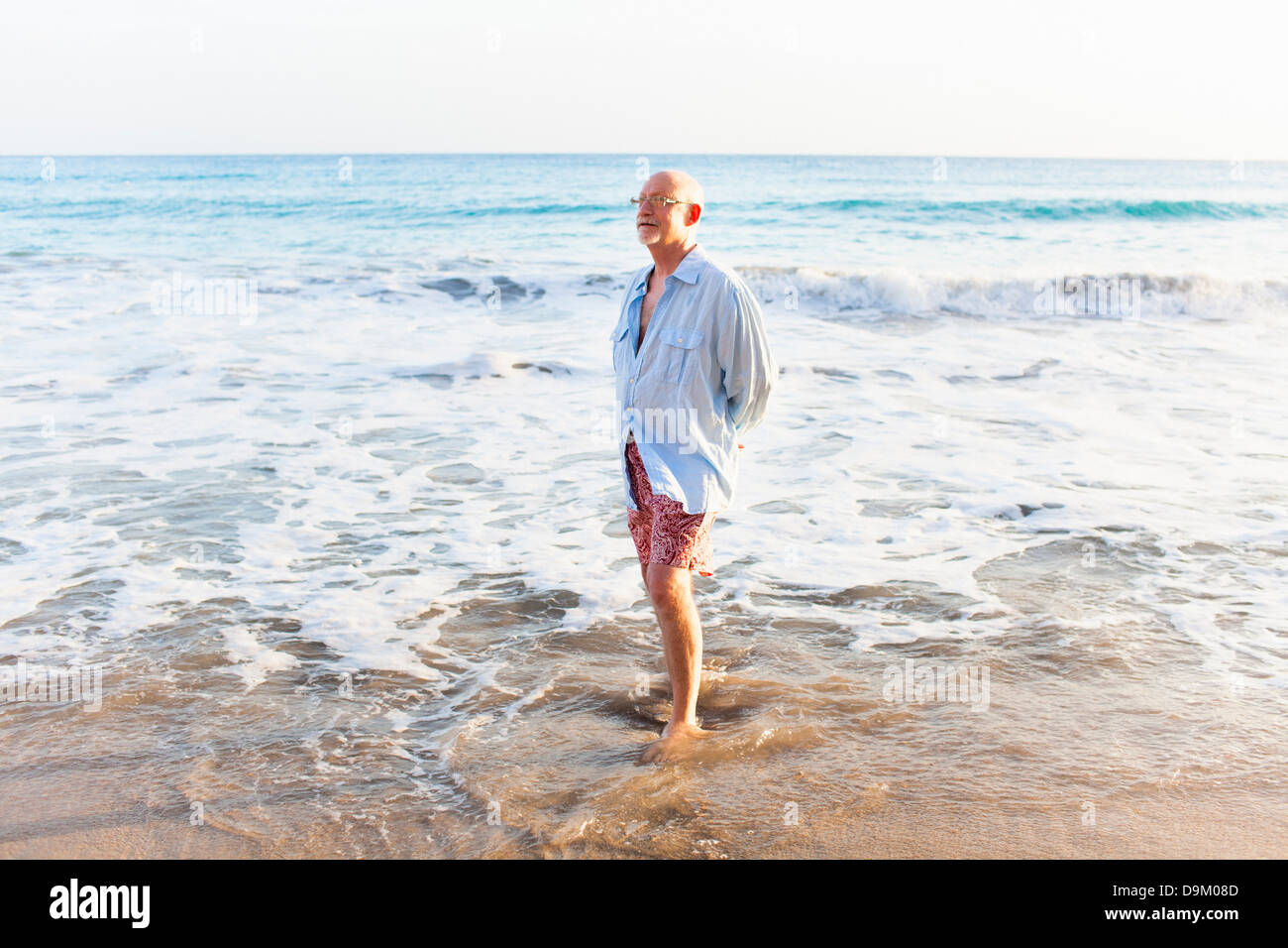 Senior man at water's edge, St Maarten, Netherlands - Stock Image
