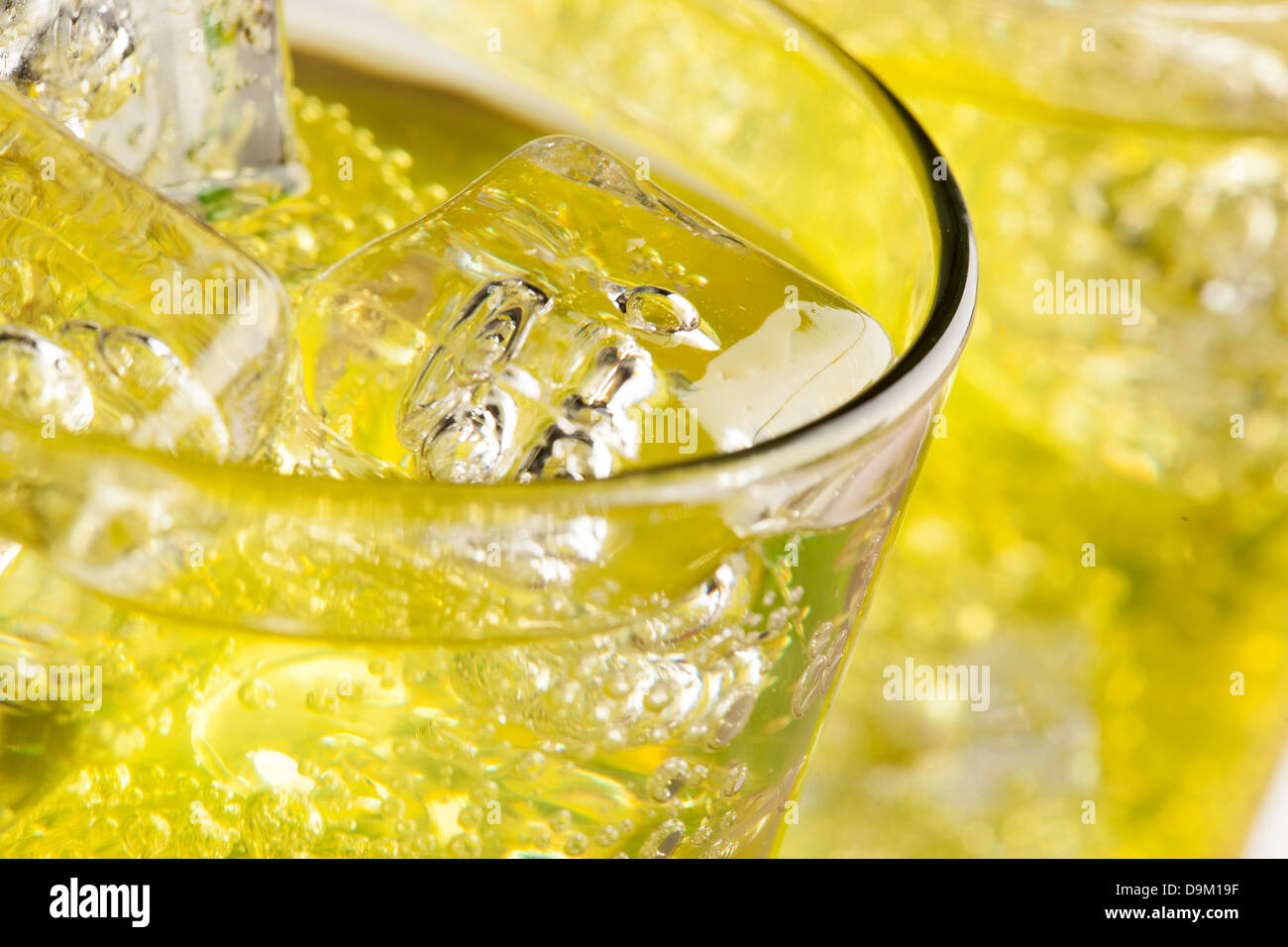 Green Energy Drink Soda against a background - Stock Image