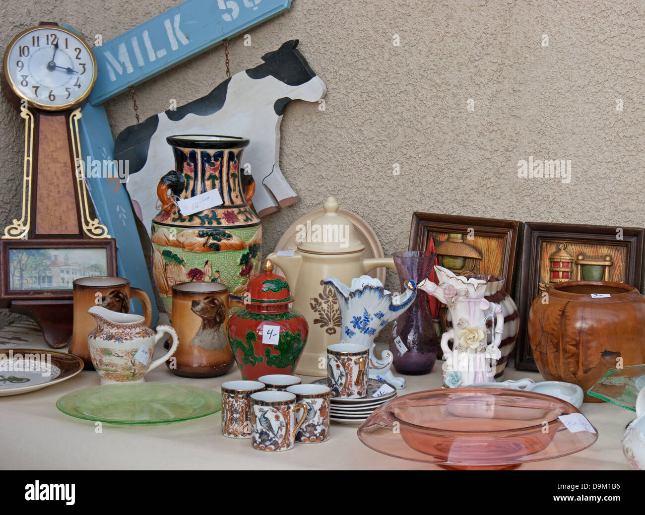 Yard garage estate tag sale antiques and vintage smalls on display with blank space for message. - Stock Image
