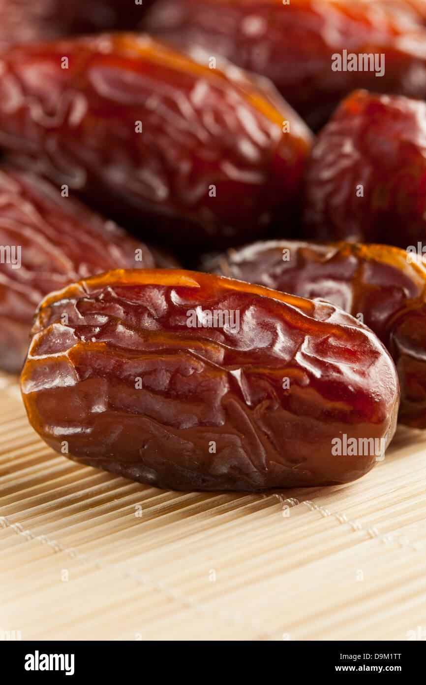 Fresh Organic Raw Brown Date Fruit against a background - Stock Image