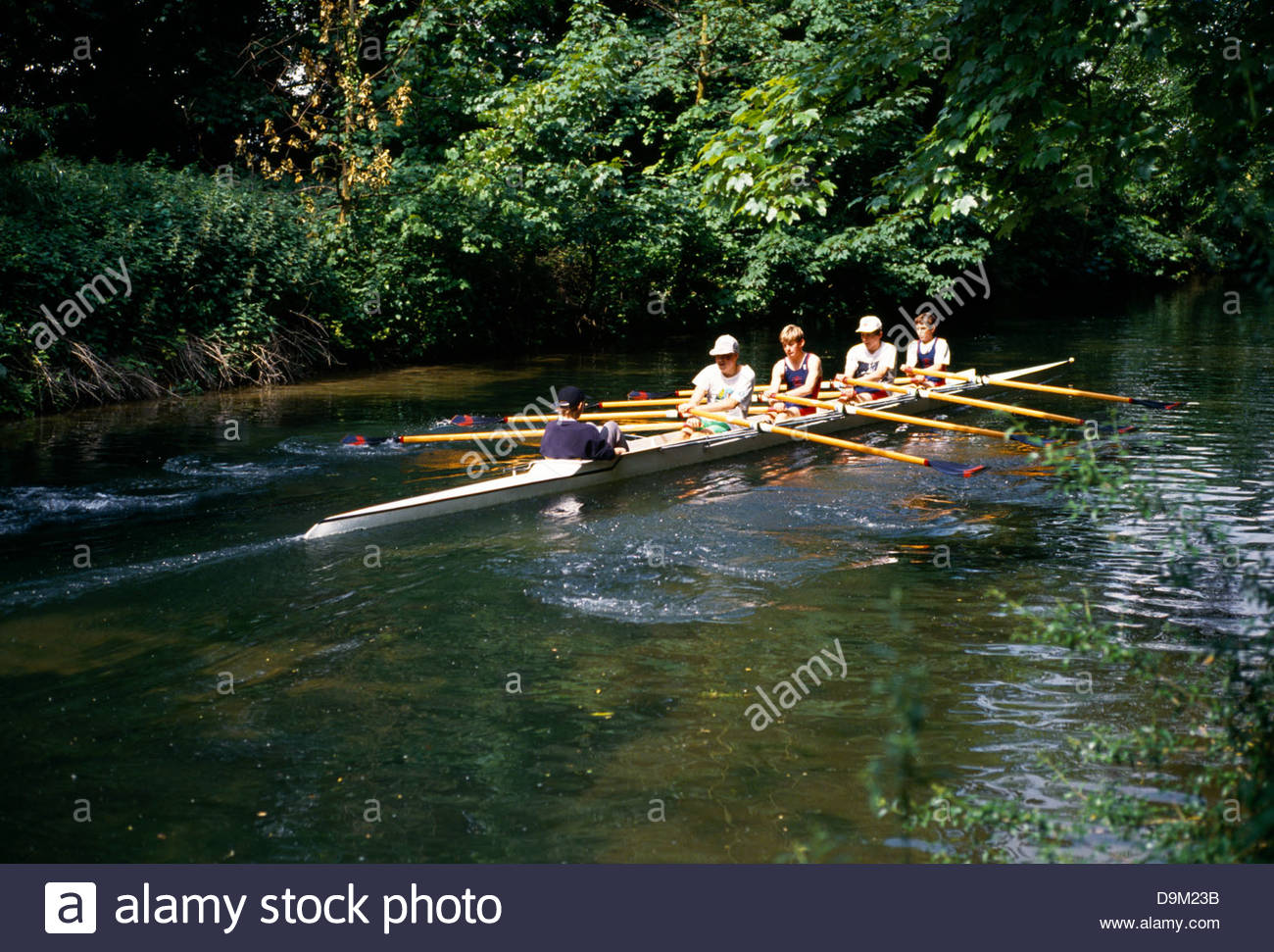 Teenage Boys Rowing On River Itchen Winchester England - Stock Image