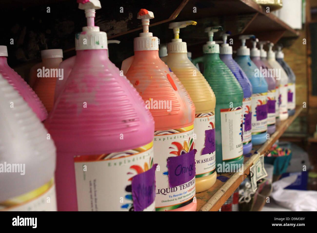 bottles pumps paint colors multi rainbow row - Stock Image