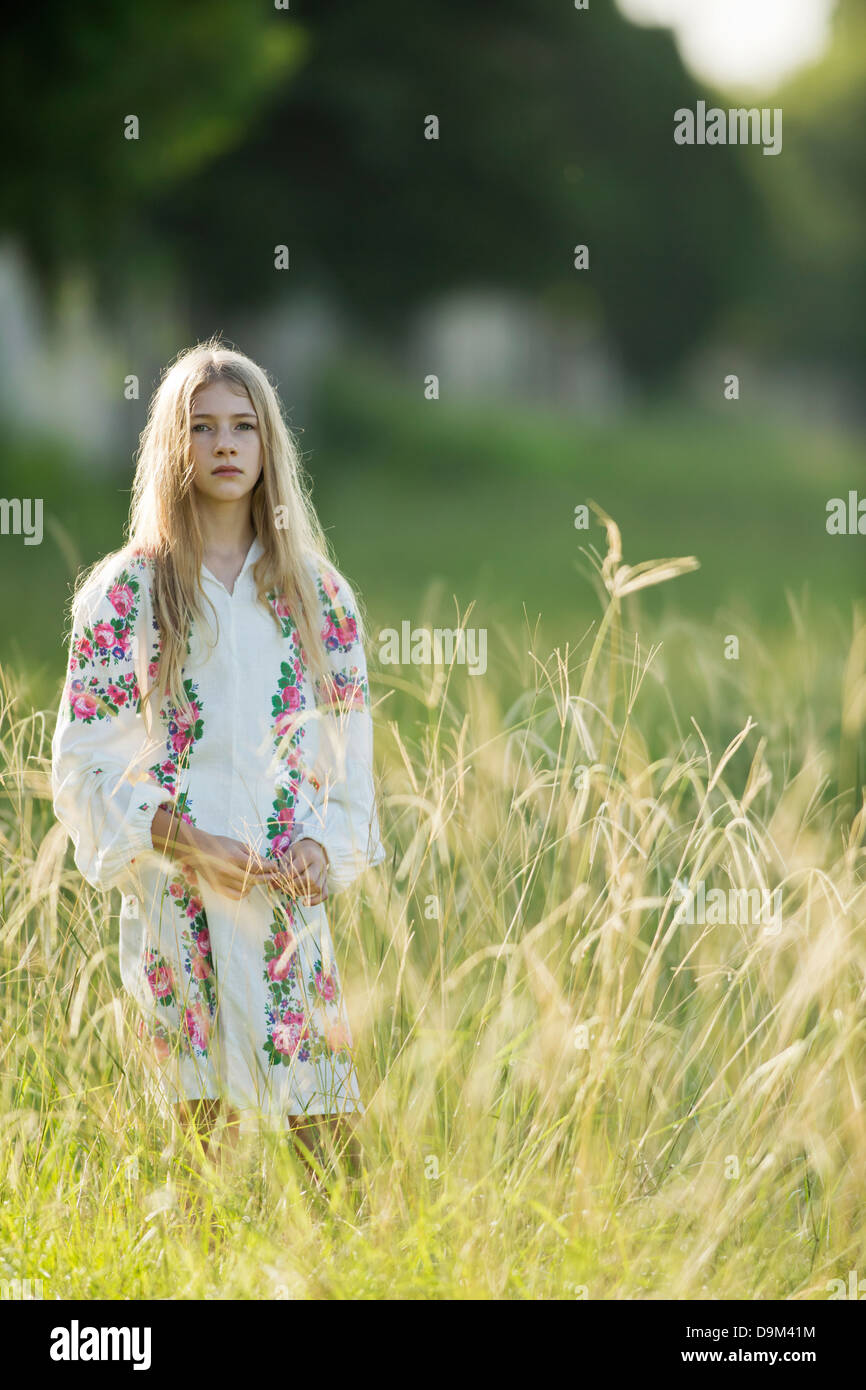 Portrait of young girl in the field,wearing Slavic costume Stock Photo