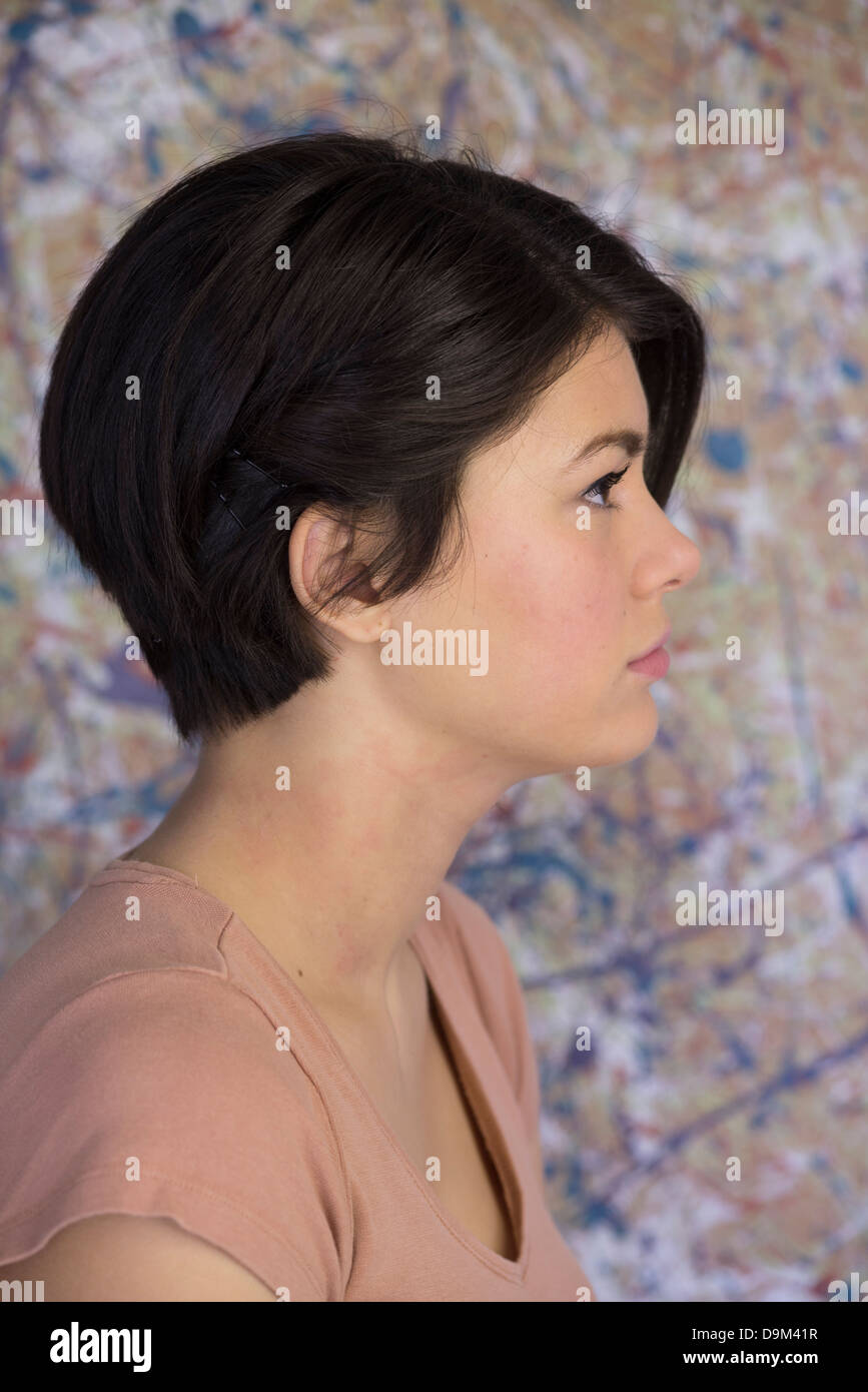 Confident attractive 16 year old girl with asymmetrical haircut - Stock Image