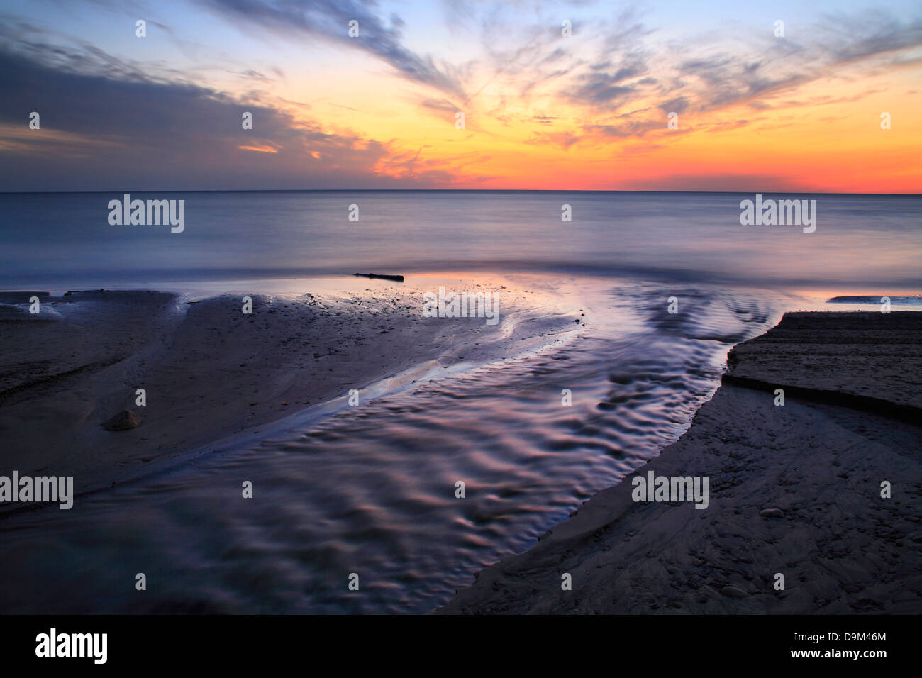 A Blazing Sunset Over Lake Erie At The Mouth Of Crooked Creek, Dunkirk New York, USA Stock Photo