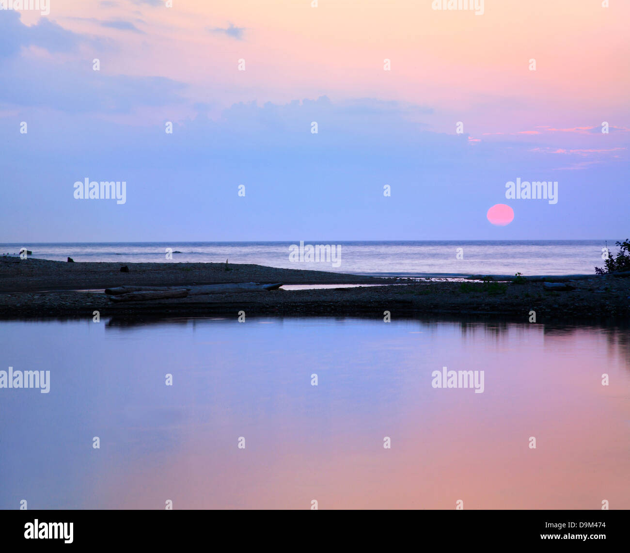 A Colorful Sunset Over Lake Erie At The Mouth Of Elk Creek Near Lake City Pennsylvania, USA - Stock Image