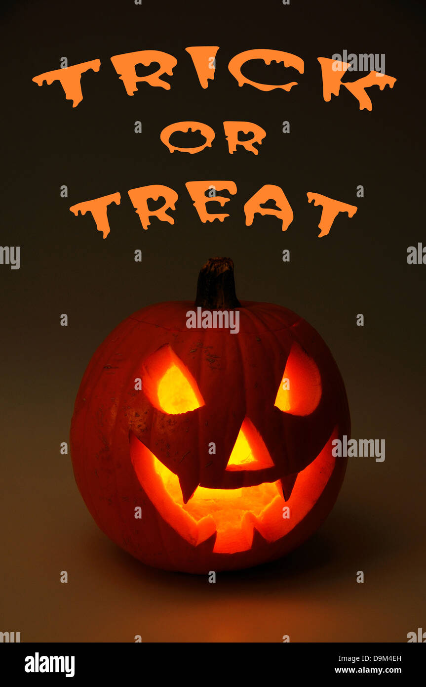 Scary face cut into pumpkin for Halloween (lit from the inside). - Stock Image
