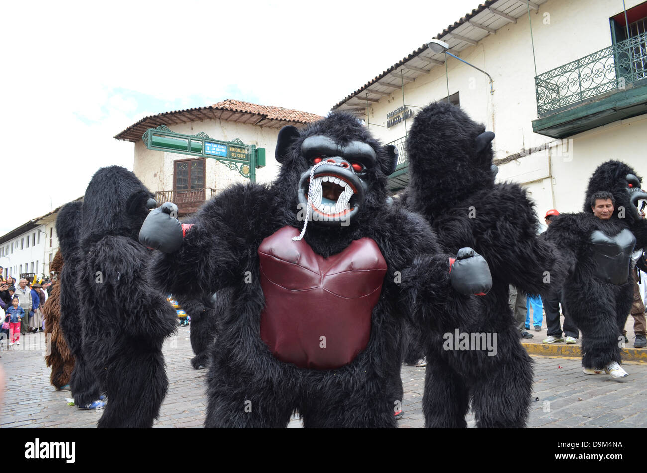 Dancers wearing Gorilla costumes during a parade in Cuzco Peru & Dancers wearing Gorilla costumes during a parade in Cuzco Peru ...