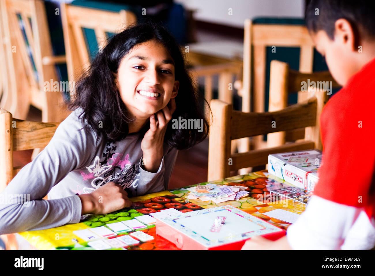 Daughter playing board game - Stock Image