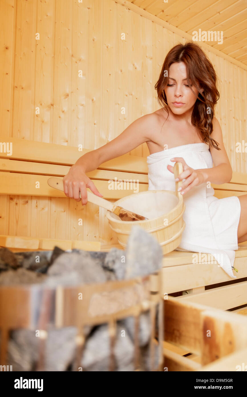 Young woman in the sauna - Stock Image