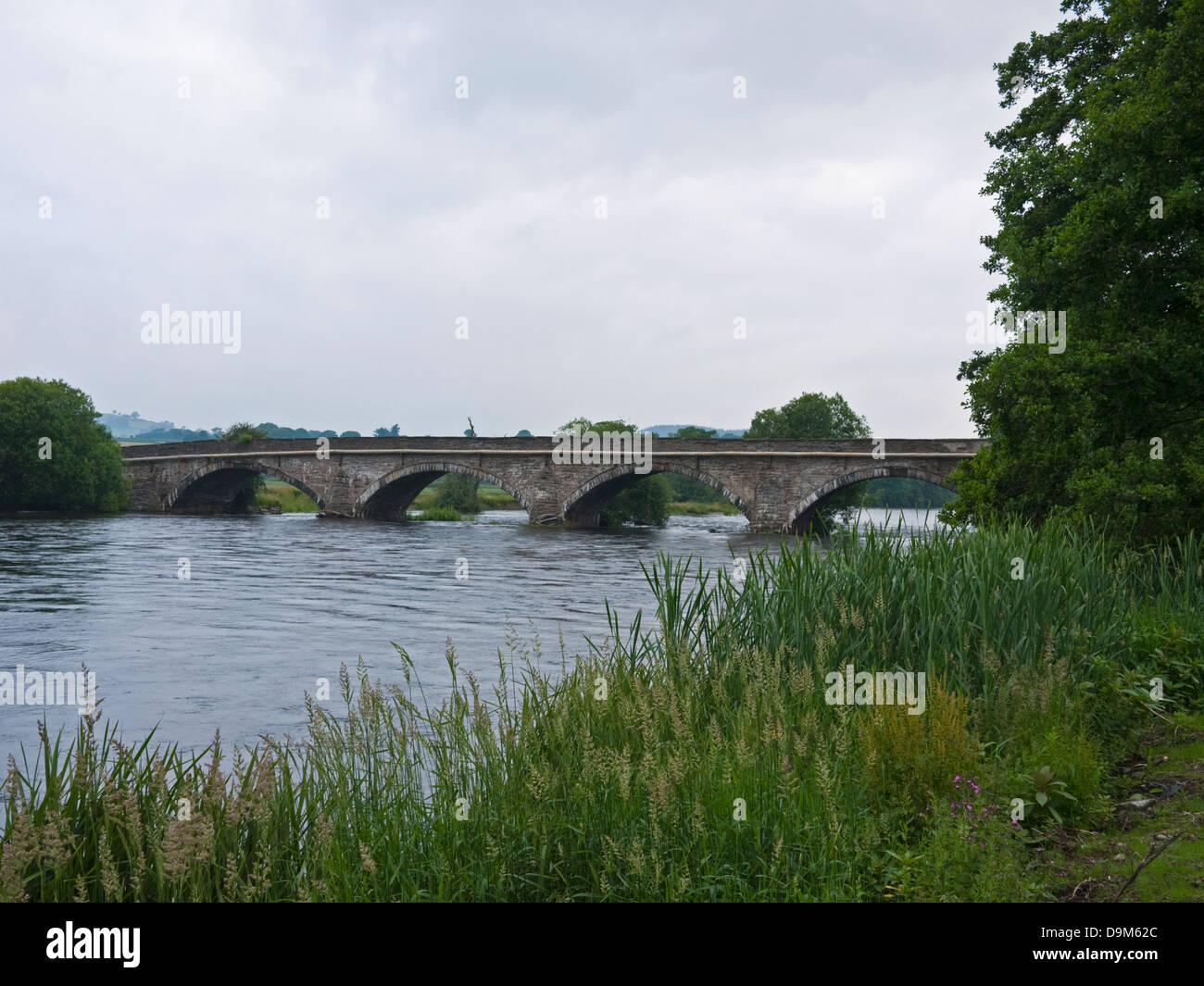 Pont Corwen, carrying the A5 road over the River Dee / Afon Dyfrdwy outside the Denbighshire town of Corwen, North - Stock Image