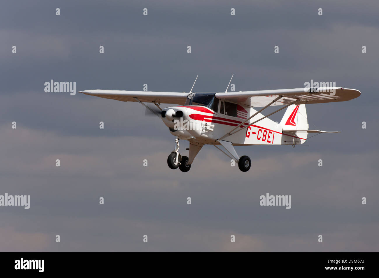 Piper PA-22-108 Colt G-CBEI in flight on final approach to