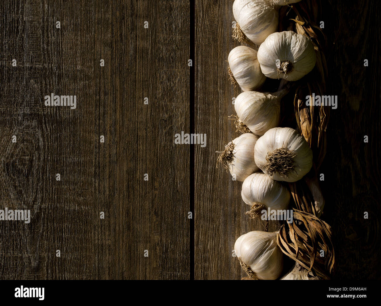 Bunch of garlic on a wooden table. - Stock Image
