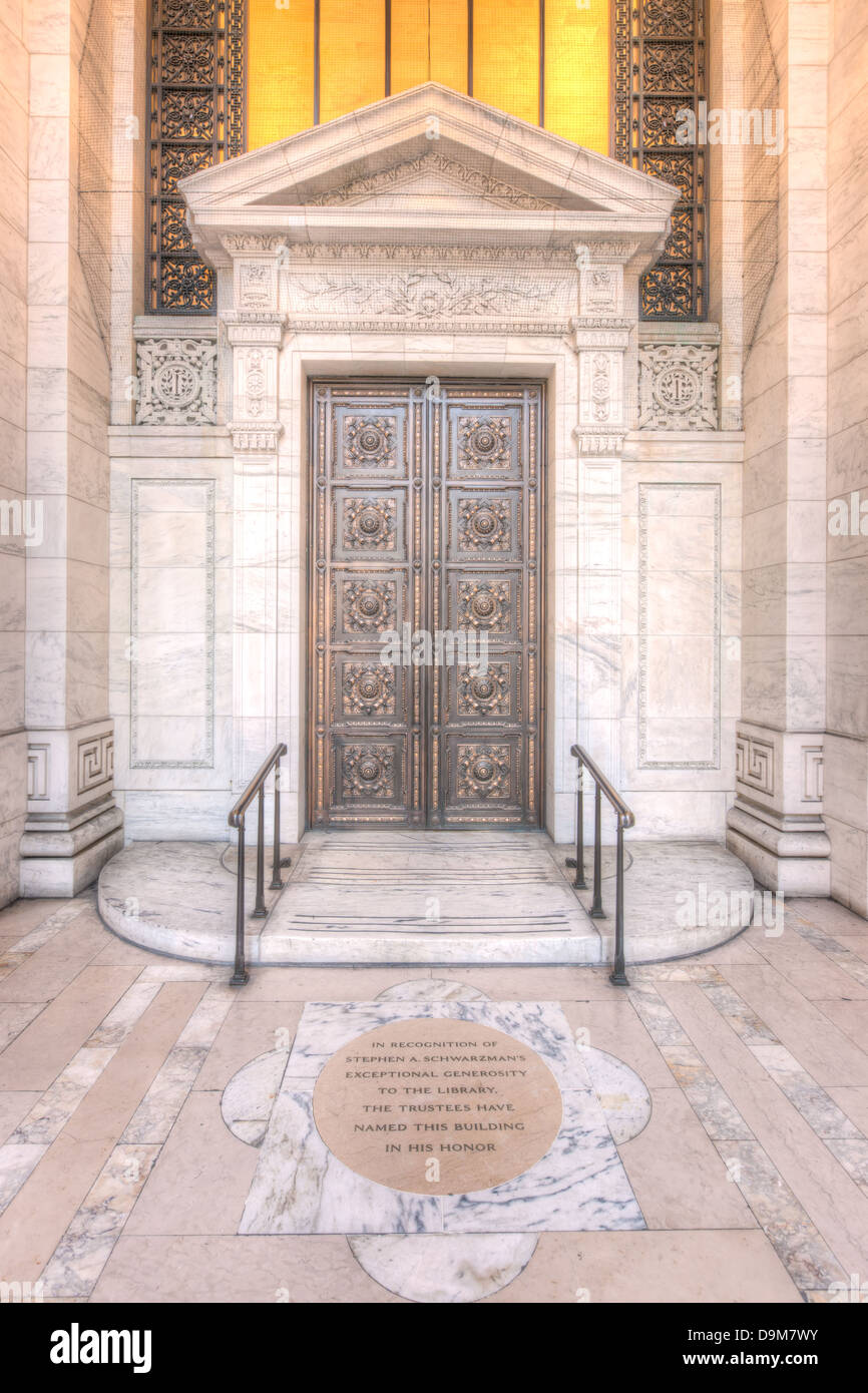 Bronze doors adorn the main entrance to the New York Public Library's Beaux-Arts Stephen A. Schwarzman Building - Stock Image
