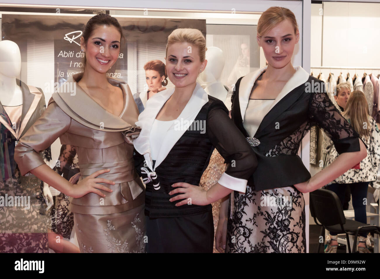 Milan, Italy - June 21, 2013: People visit SposaItalia, international exhibition of bridal and formal wear in Milan. - Stock Image