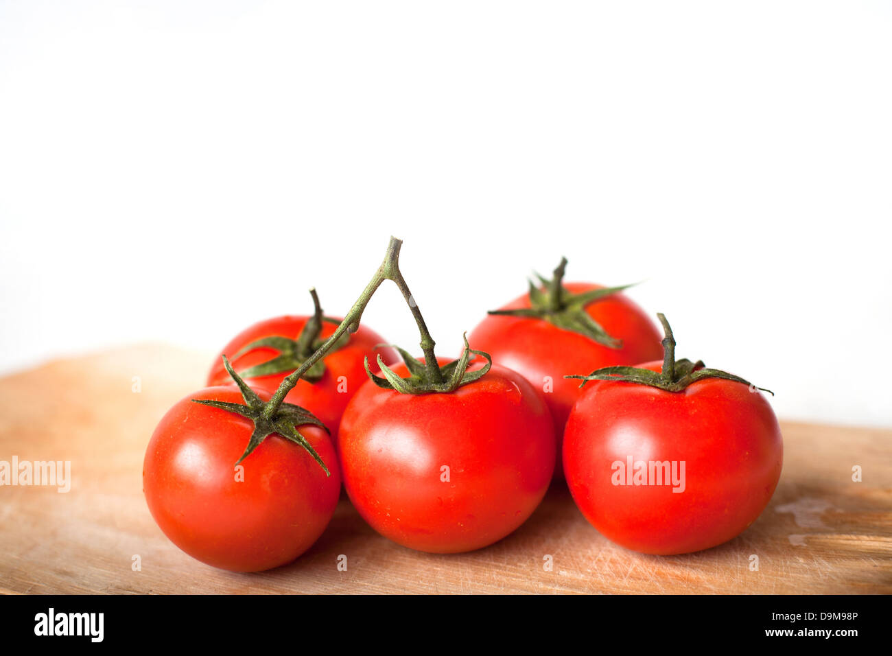 tomatoes in the kitchen isolated on white Stock Photo