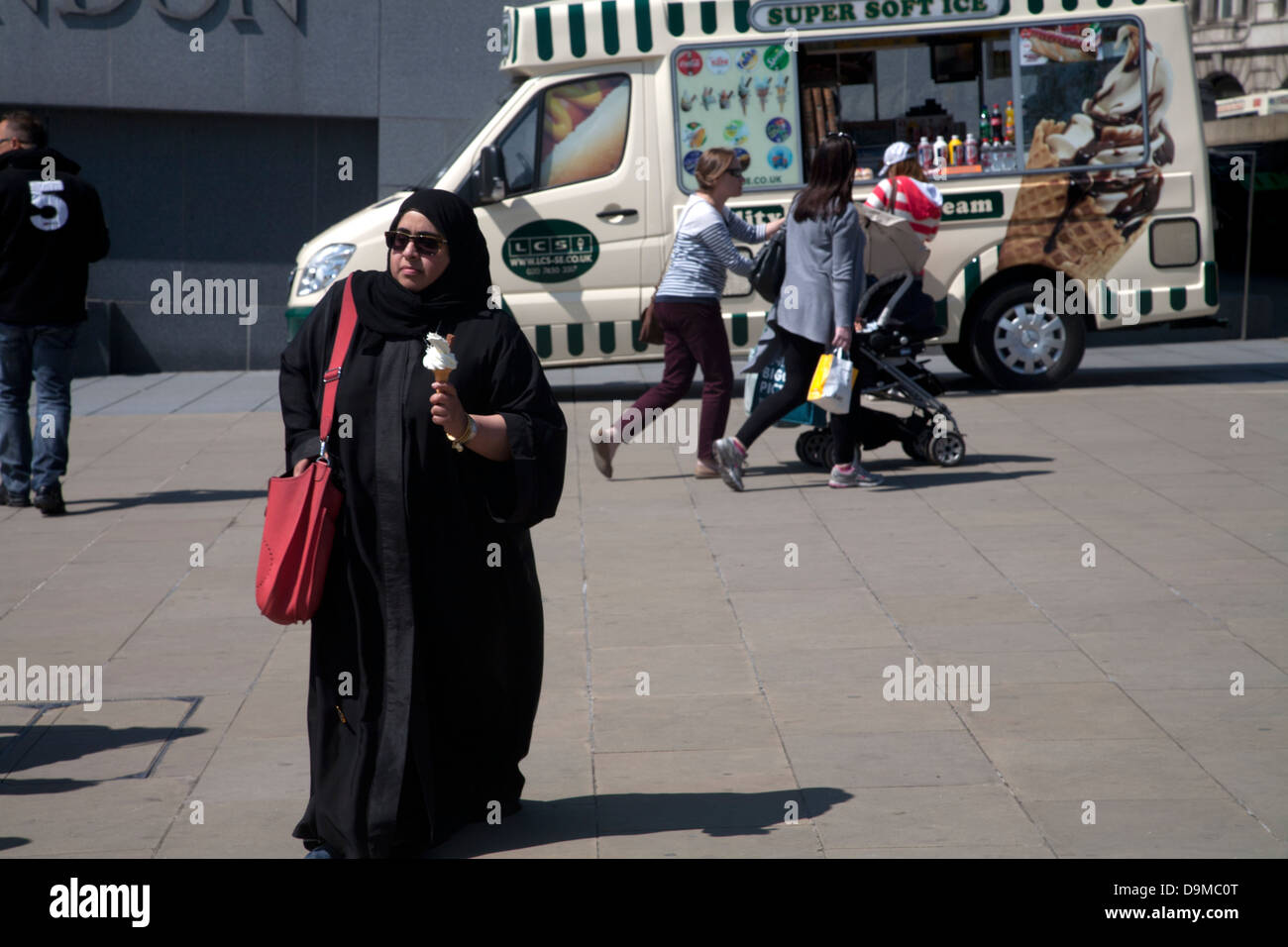 moslem woman with ice cream tower hill london england - Stock Image