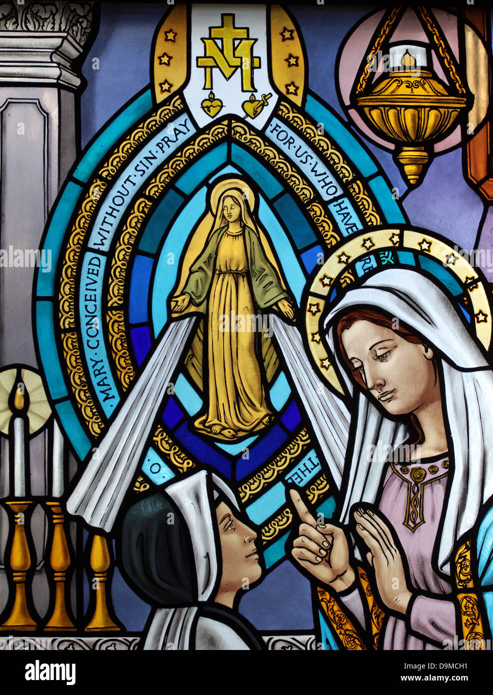 Stained glass art in the windows of the Mary, Queen of the Universe Shrine of Orlando, Florida. - Stock Image