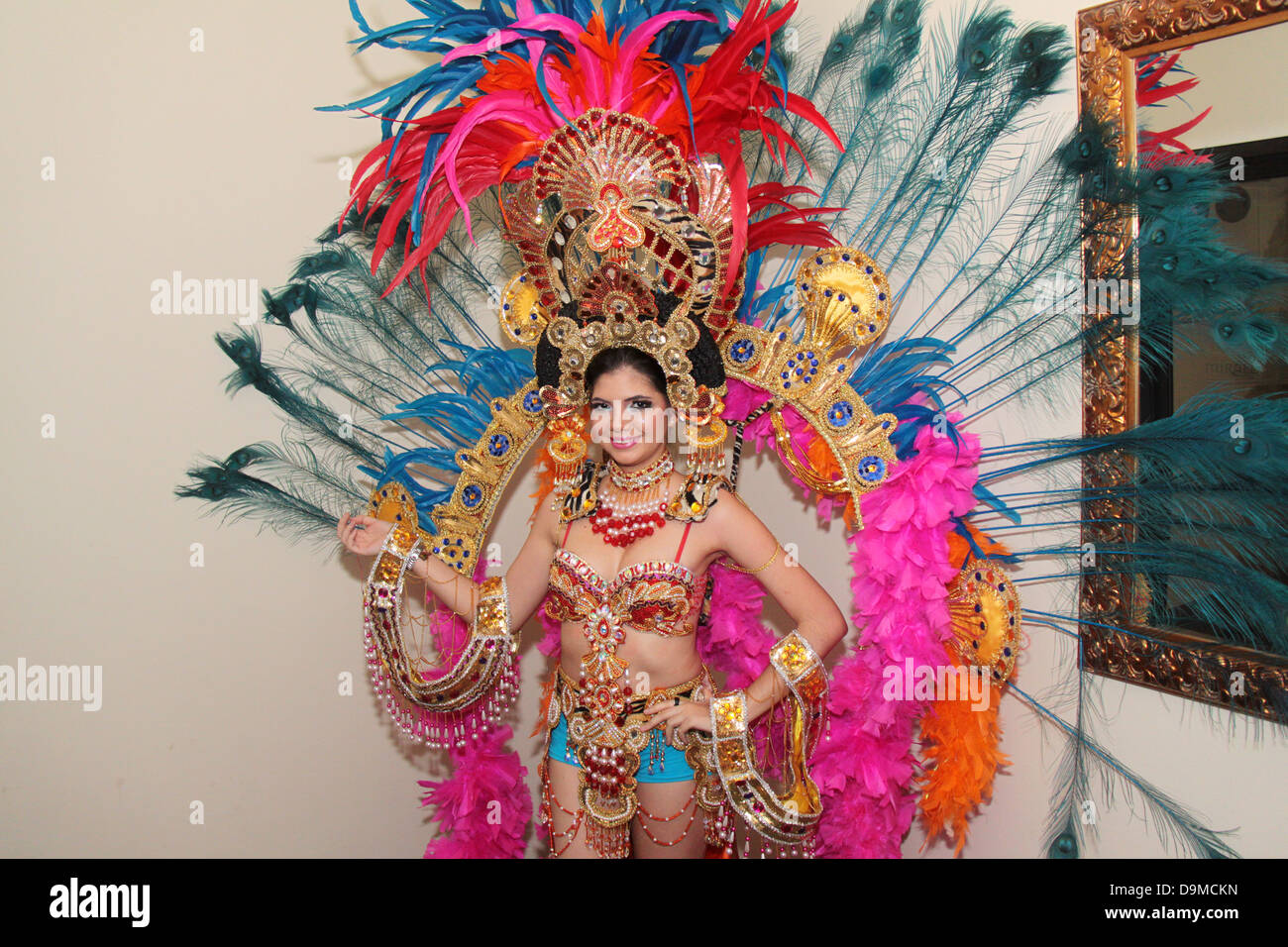 young woman wearing a traditional fantasy carnival costume pumpkin girl pumpkin girl meaning