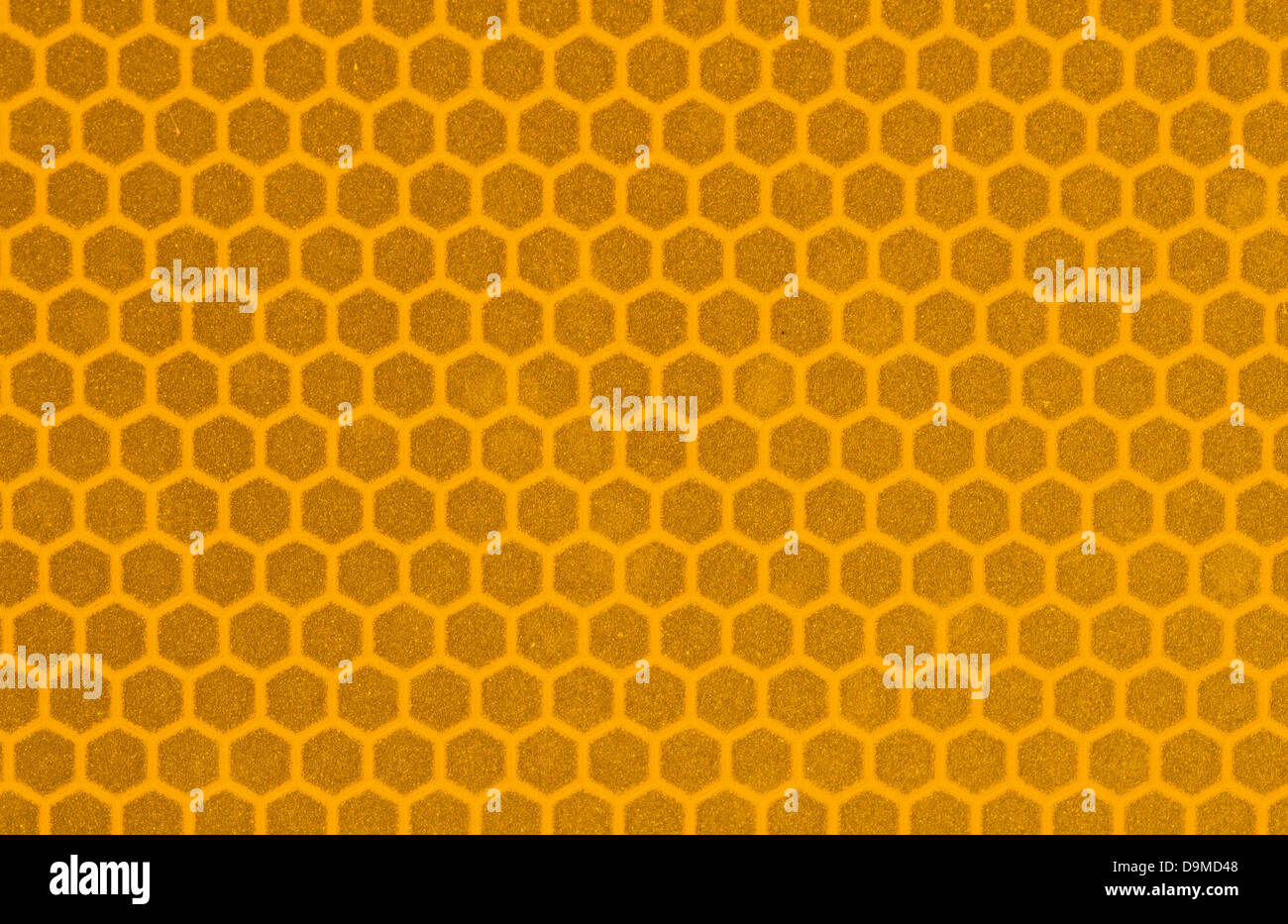 macro image of yellow reflective sign surface with hexagonal pattern - Stock Image