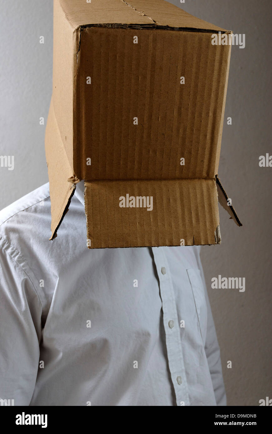 Man with box on head Stock Photo
