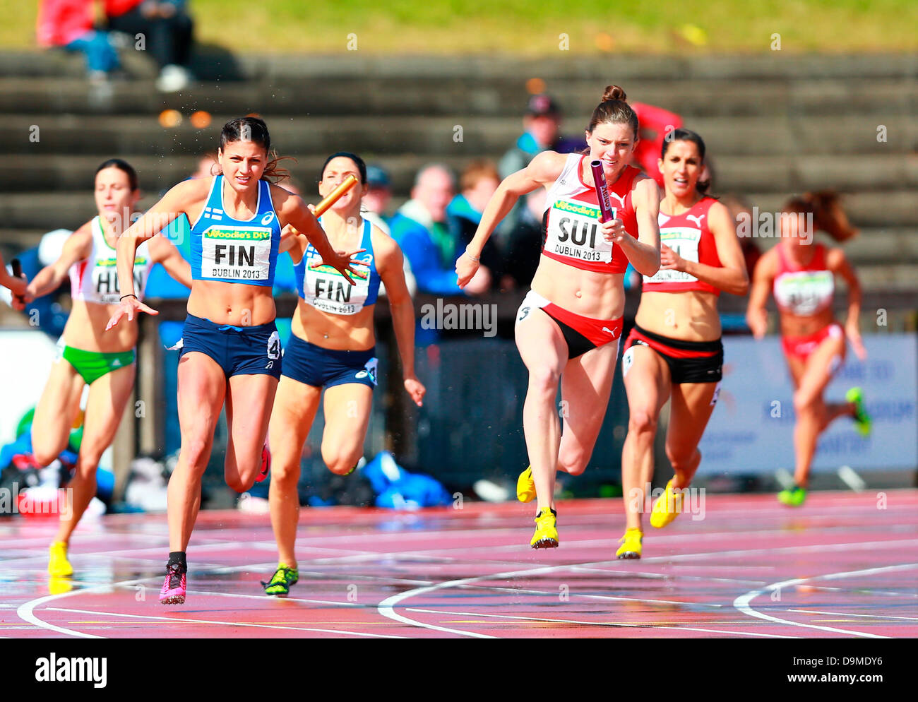 Dublin, Ireland. 22nd June, 2013. The vital handover in the womens 4x100m during the European Athletics Team Championships - Stock Image