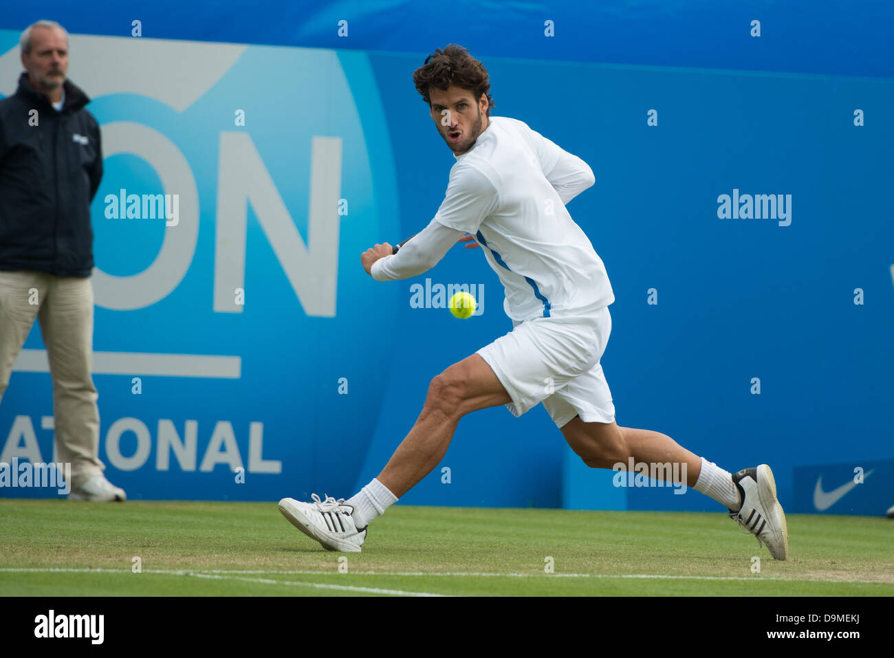 Eastbourne, UK - 22nd June 2013. Feliciano Lopez of Spain in action hitting a running single handed backhand in - Stock Image