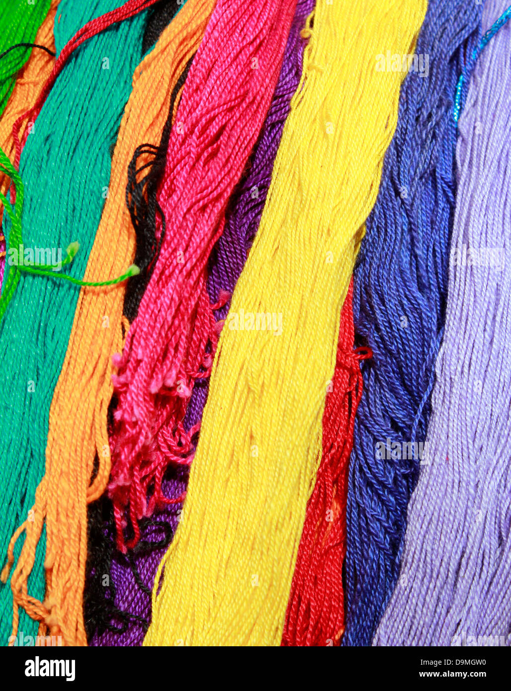 colourful threads at a local market in delhi - Stock Image