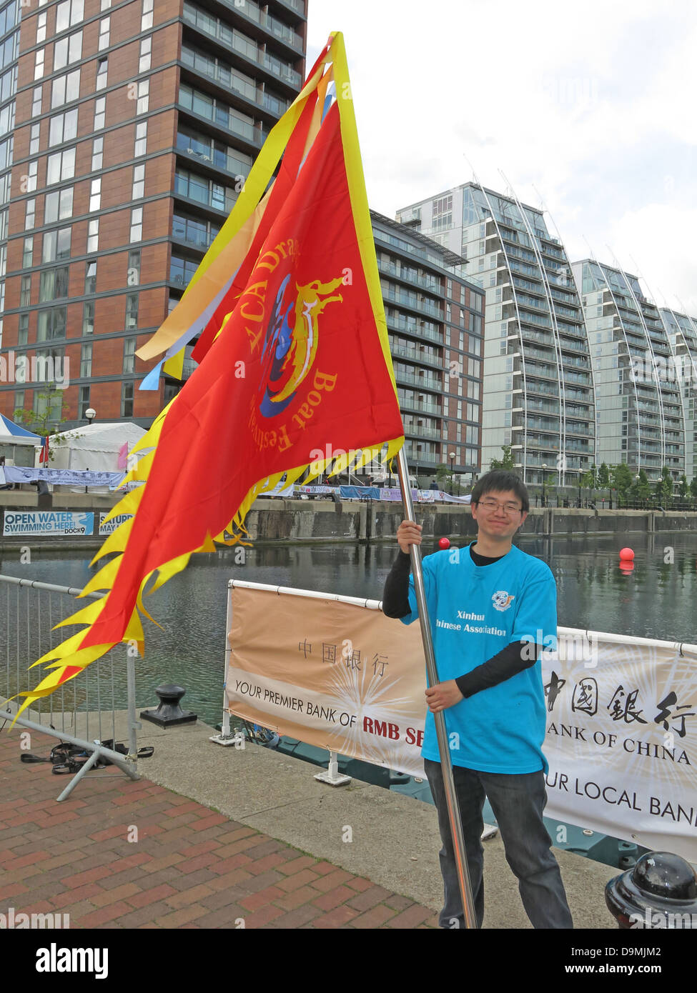 Flying the flag at Salford Quays Salford First Dragon Boat race June 16th 2013, Manchester, UK - Stock Image