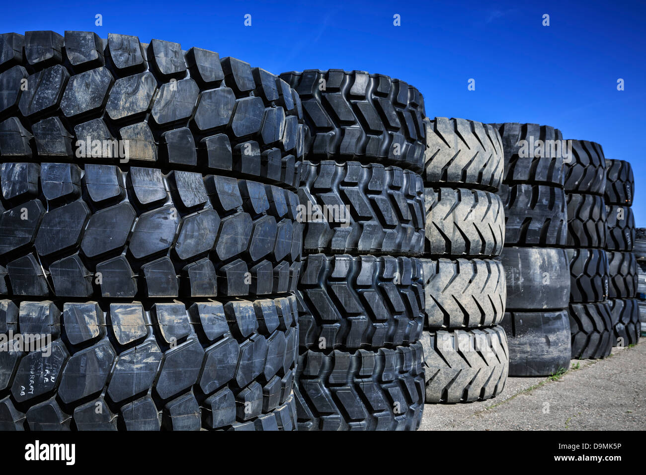 Large rubber tires, stacked up - Stock Image
