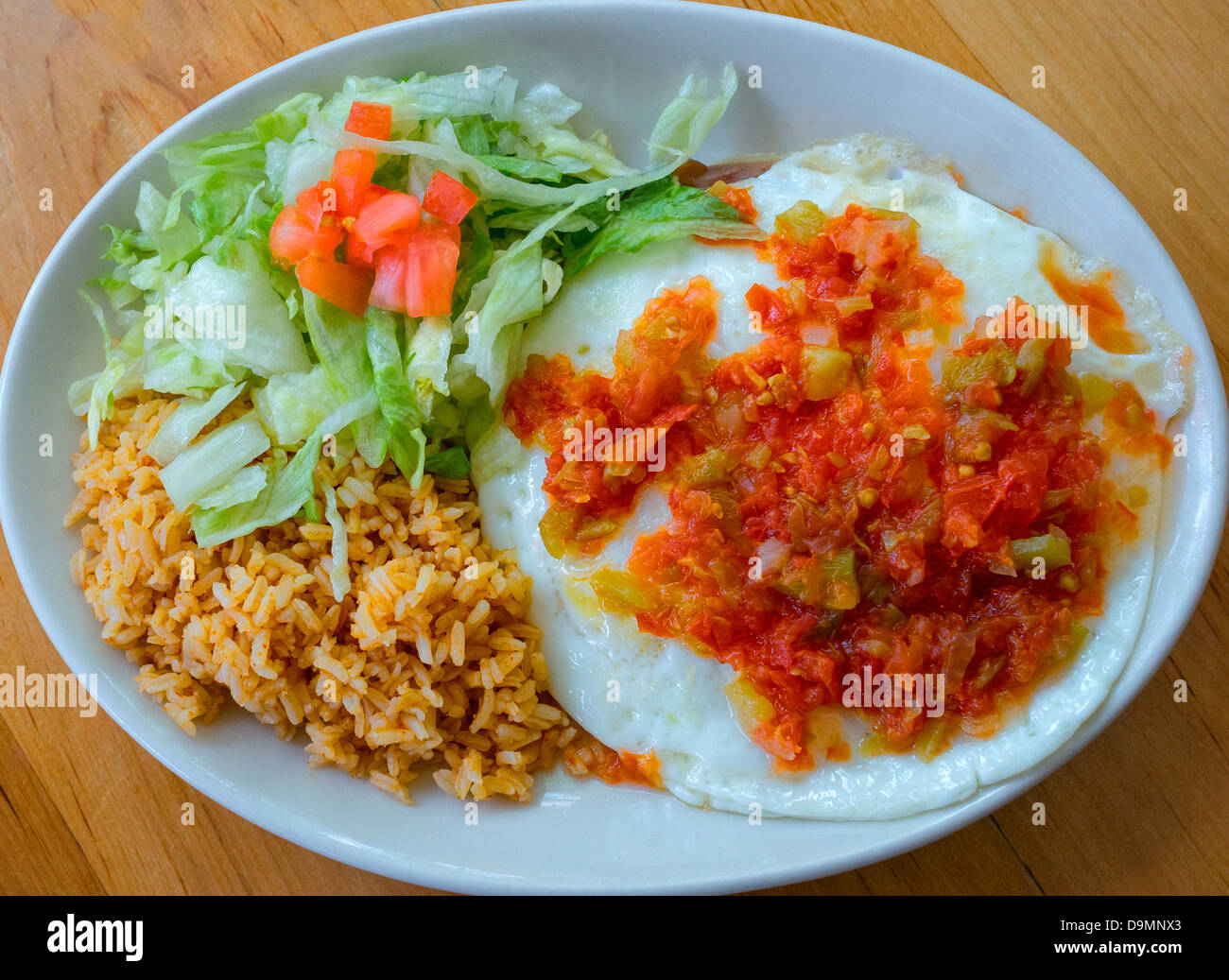 Mexican style eggs or Huevos Rancheros - Stock Image