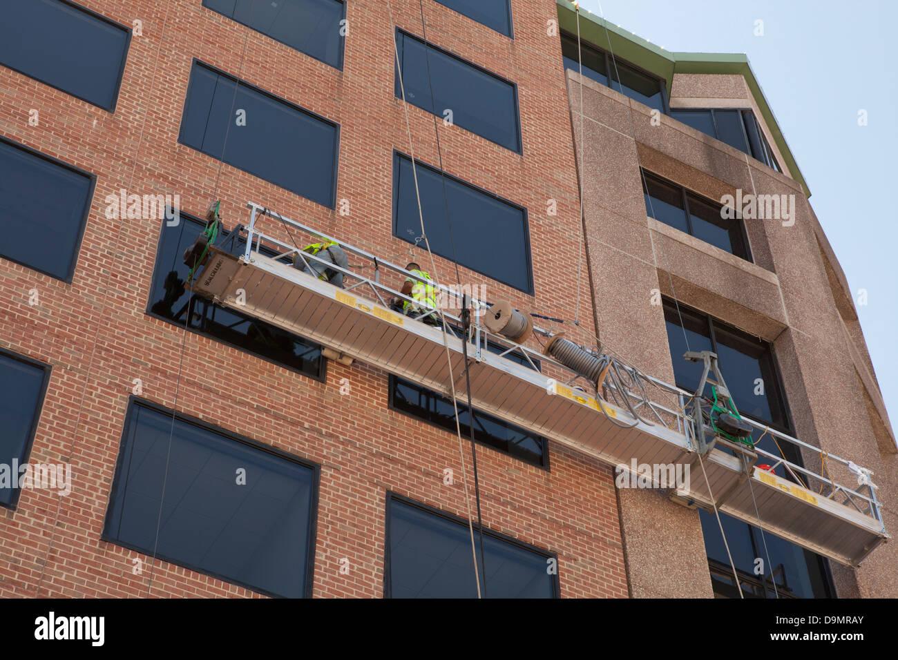 Men working on areal work platform - USA - Stock Image