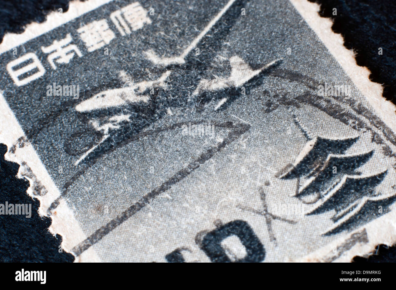 old japanese postage stamp in studio setting - Stock Image