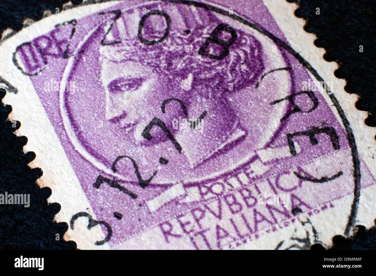 old italian postage stamp in studio setting - Stock Image