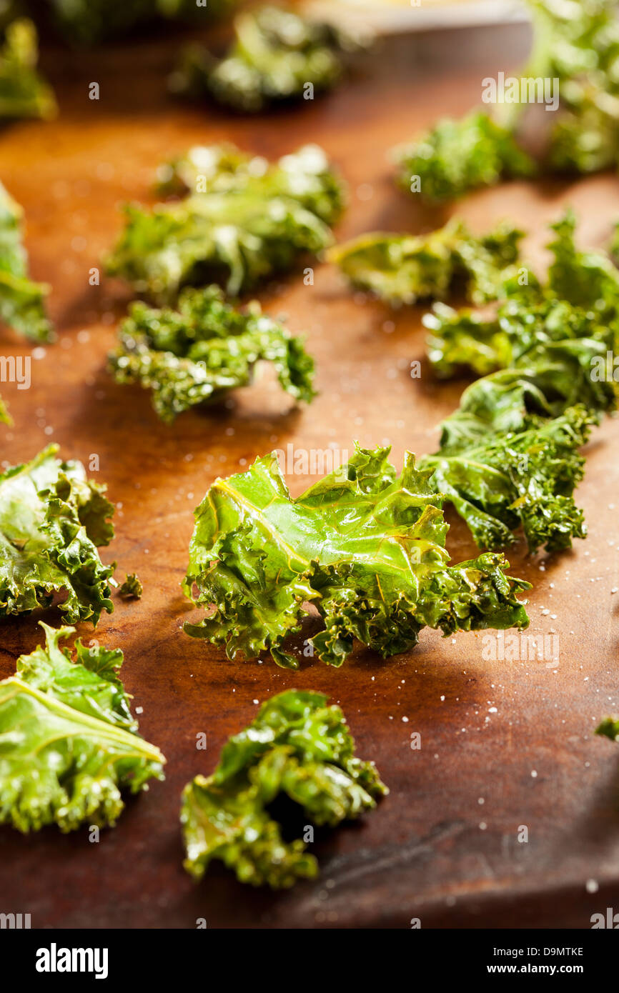 Homemade Organic Green Kale Chips with salt and oil - Stock Image