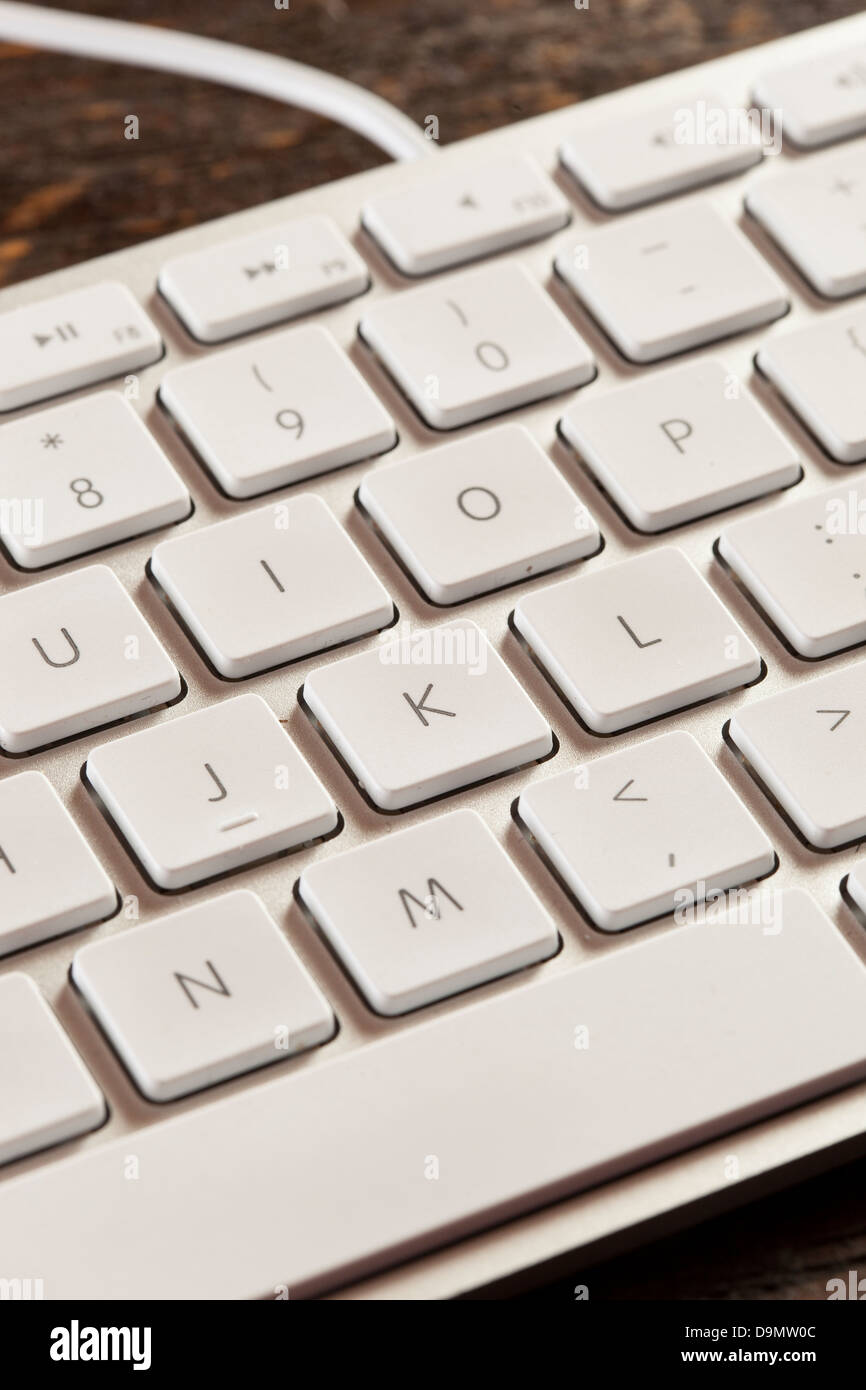 Grey Computer Keyboard with white keys for typing - Stock Image
