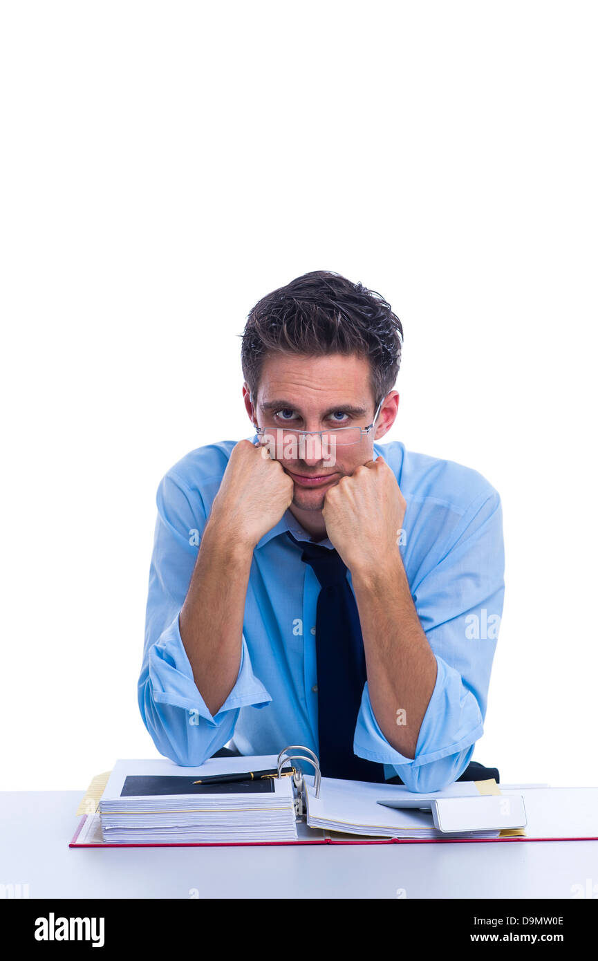 Businessman doubts his work (model release) - Stock Image